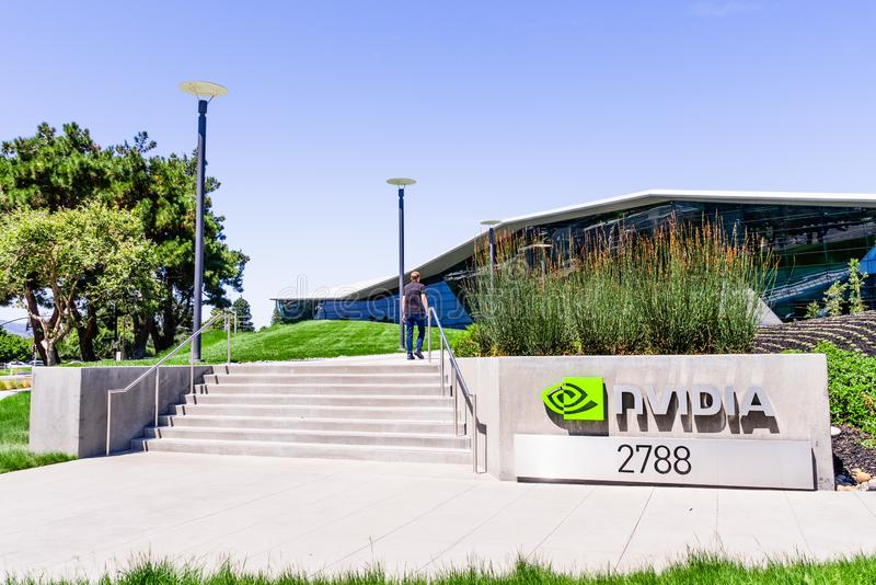 August 9, 2019 Santa Clara / CA / USA - People walking towards the entrance to Nvidia Endeavor office building at the Company`s stock image