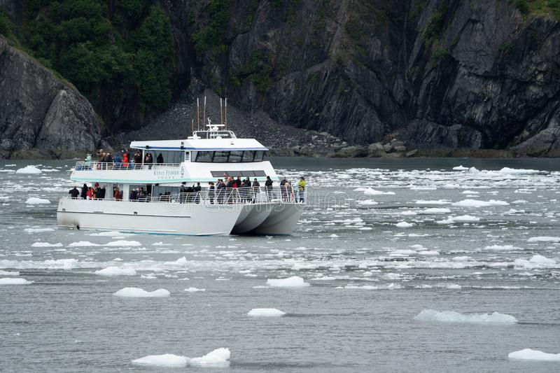 AUGUST 4 2018 - SEWARD AK: Tourist boat in Kenai Fjords National Park gets close to the beautiful scenery and icebergs royalty free stock photography