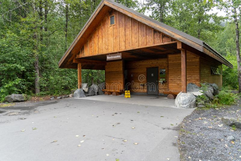 AUGUST 6 2018 - SEWARD, ALASKA: Restroom building for tourists to use the bathroom, at Kenai Fjords National Park, Exit Glacier. Area. Summer day royalty free stock photos