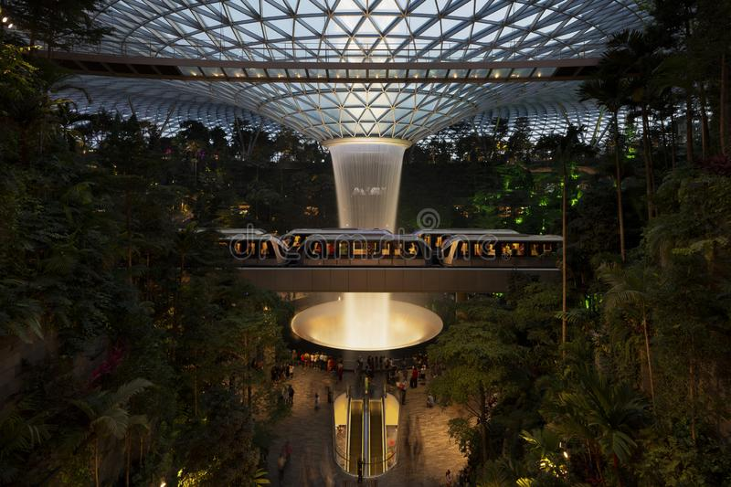 August 17, 2019 - Singapore: Indoor Waterfall at Jewel Changi Airport at night stock photos