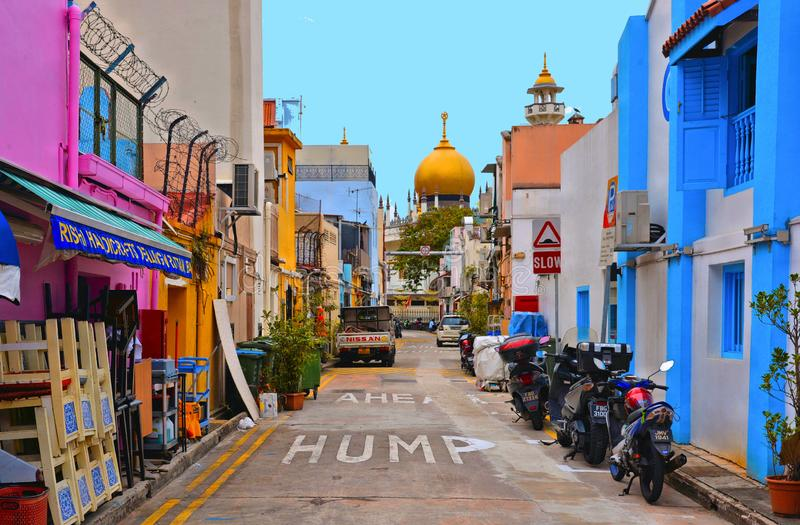 Small street with old colorful buildings, motorcycles and cars with chaotic traffic, old mosque with golden dome i royalty free stock photos