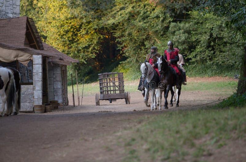 11 August 2019, Soldiers riding horses during a medieval event `Viagem Medieval em Terra de Santa Maria` in Santa Maria da Feira. 11 August 2019, Soldiers royalty free stock photos
