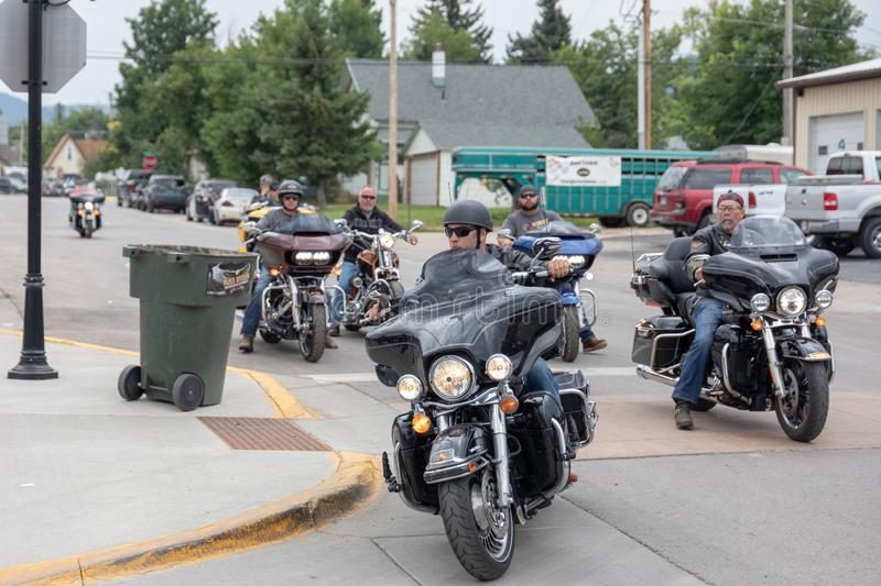 Bikers turn onto Main Street in Sturgis, South Dakota. AUGUST 5, 2018, STURGIS, SD: Bikers ride into town for the opening weekend of the 78th annual 2018 stock image