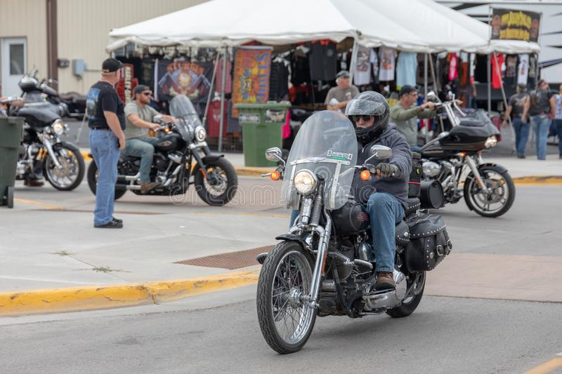 Taking a ride down Main Street in Sturgis, South Dakota. AUGUST 5, 2018, STURGIS, SD: The place to see and be seen for a biker is riding down Main Street stock images