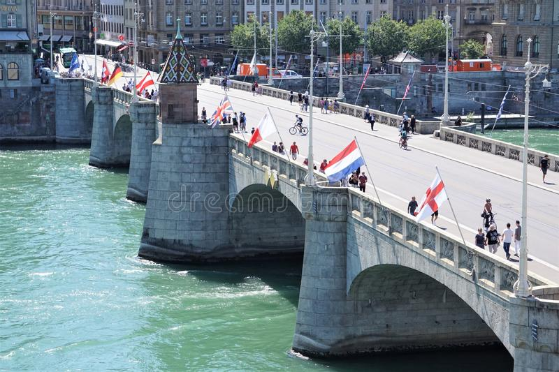 Middle bridge in Basel Switzerland with pedestrians stock image