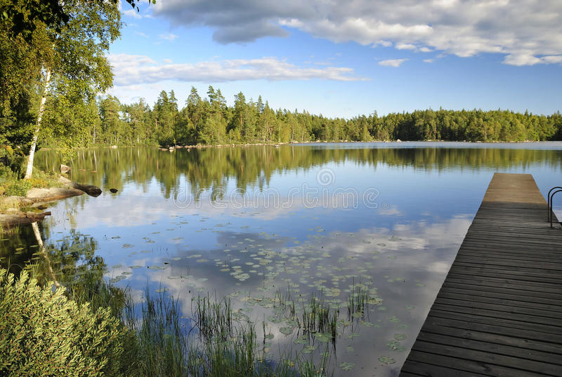 August Swedish lake landscape stock photography