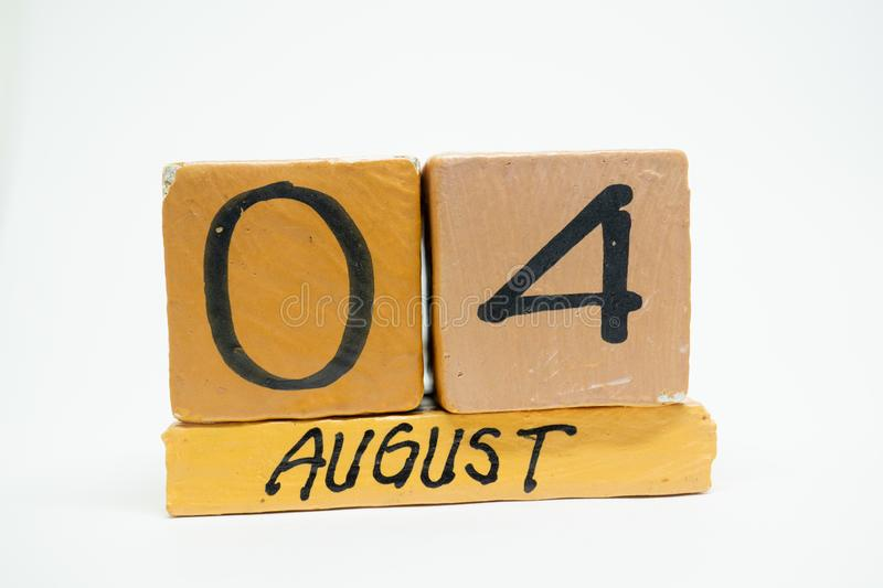 August 4th. Day 4 of month, handmade wood calendar isolated on white background. summer month, day of the year concept. August 4th. Day 4 of month, handmade wood royalty free stock photography