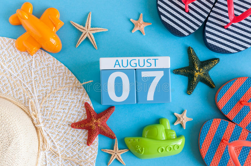 August 7th. Image of August 7 calendar with summer beach accessories and traveler outfit on background. Summer day. Vacation concept stock photos