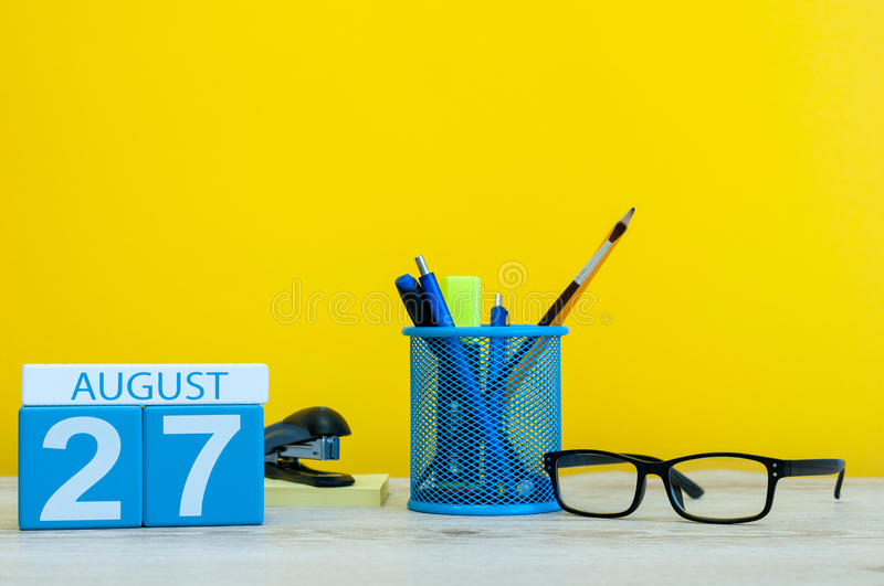 August 27th. Image of august 27, calendar on yellow background with office supplies. Summer time.  royalty free stock photography