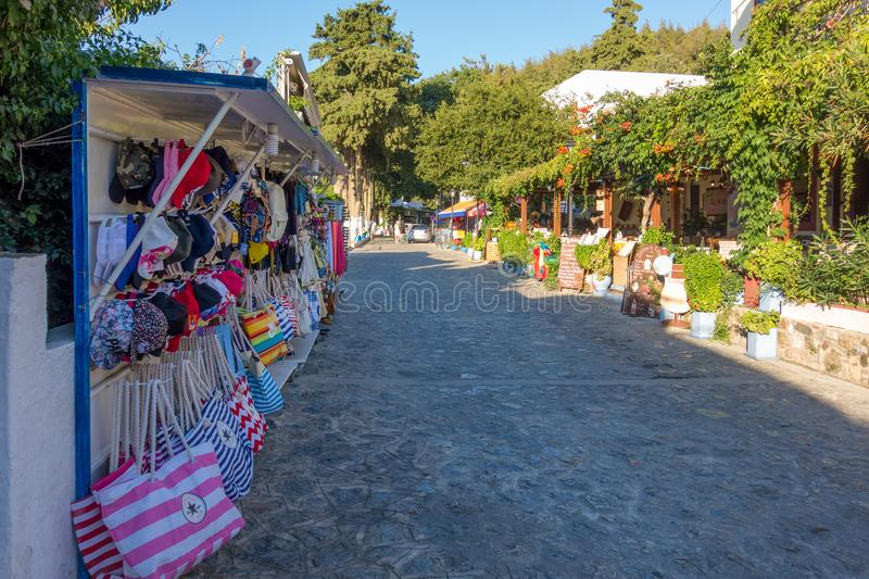 August 26th 2017 - Kos island, Dodecanese, Greece - Street with touristic shops and taverns in the traditional Zia village in Kos royalty free stock image