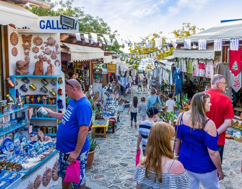 August 26th 2017 - Kos island, Dodecanese, Greece - Street with touristic shops and taverns in the traditional Zia village in Kos. Island royalty free stock image