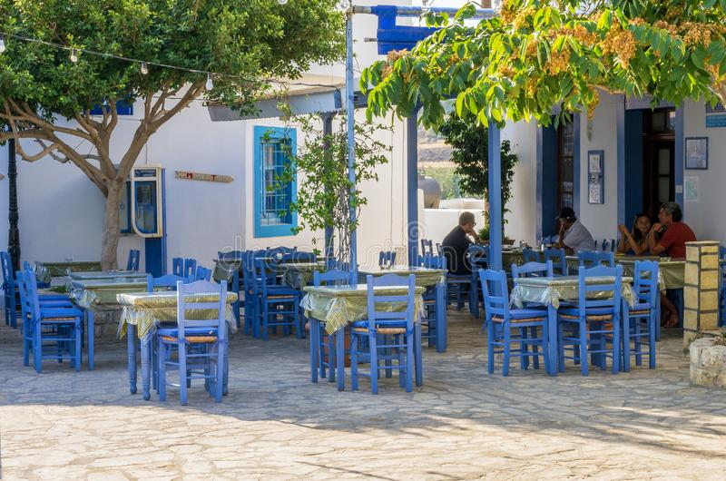 August 24th 2017 - Lipsi island, Greece - A small tavern in the central square of Lipsi island, Dodecanese, Greece. Amazing view to thAugust 24th 2017 - Lipsi royalty free stock images