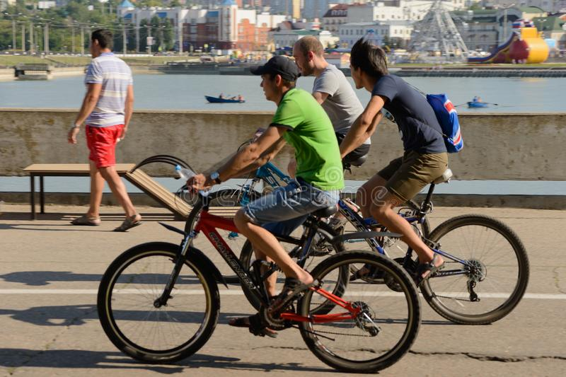 August 7, 2016: Three cyclists ride along the promenade stock photos