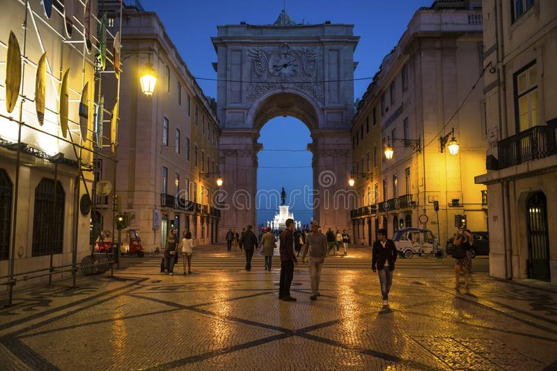People walking in Augusta Street at night, Lisbon, Portugal stock photography