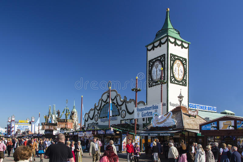 Augustiner tent at Oktoberfest in Munich, Germany, 2015. Main street at Oktoberfest with the Augustiner tent on Theresienwiese and its famous tower stock photos