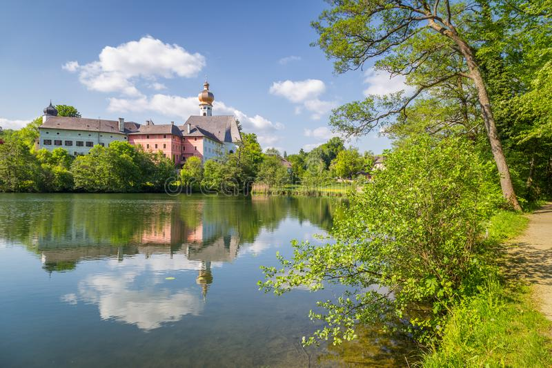 Augustinian Cloister of Höglwörth in summer, Bavaria, Germany. Classic panoramic view of famous Augustinian Cloister of Hoglworth on a beautiful sunny day stock photography
