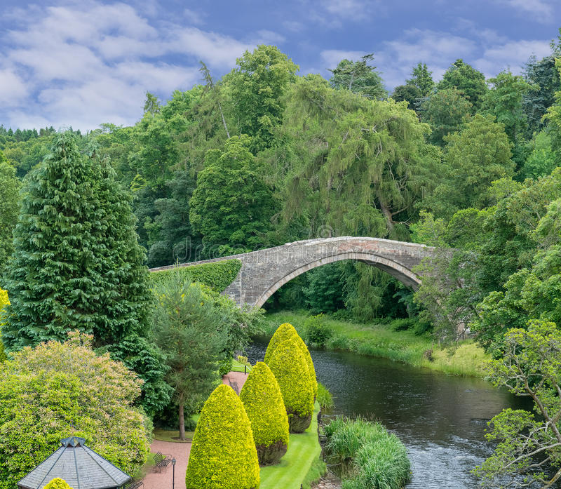 The Auld Brig Alloway Ayr Scotland. Agianst blue skys with white clouds on a clear summers day stock image