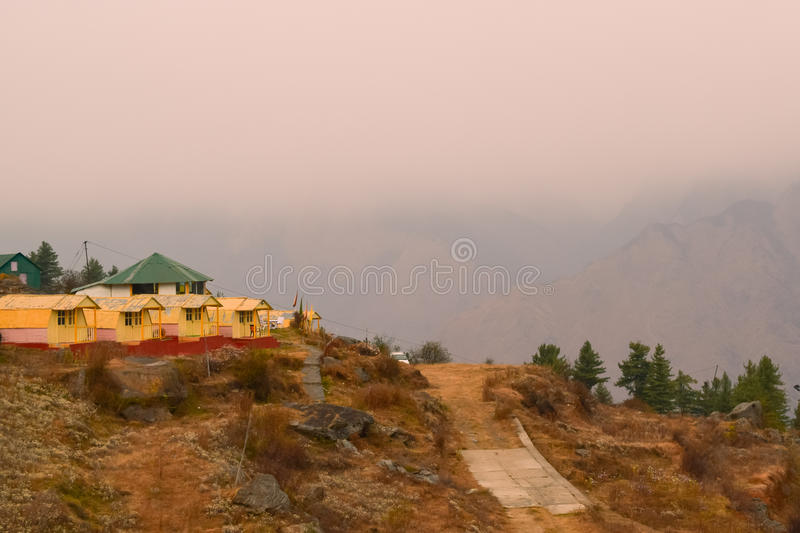 Auli Hill station on an overcast morning. Cottages at picturesque hill station Auli of Uttrakhand. Tranquility and panoramic view of Himalayan ranges are main royalty free stock photos