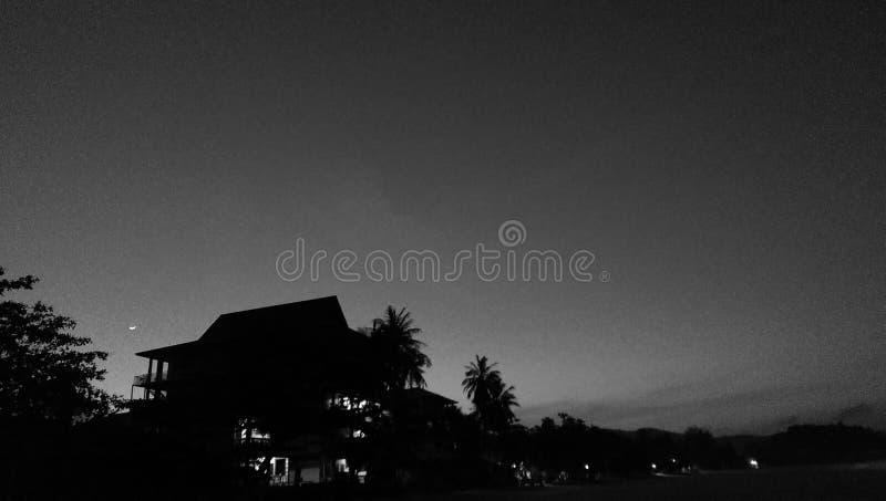 Aumento della luna di Sun di B&W fotografie stock
