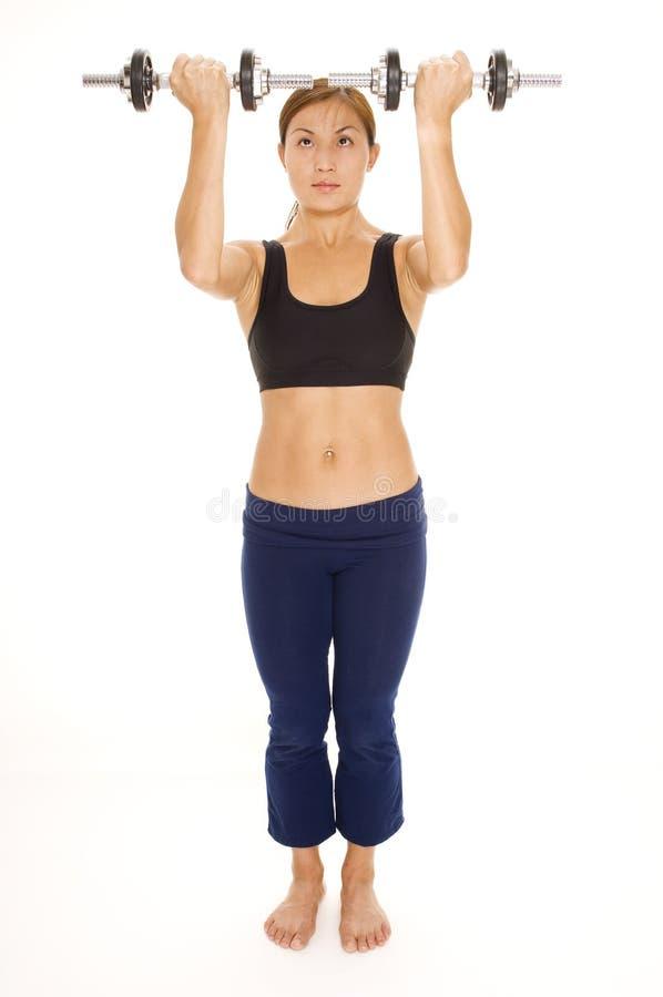 Aumento della spalla di Dumbbell fotografia stock