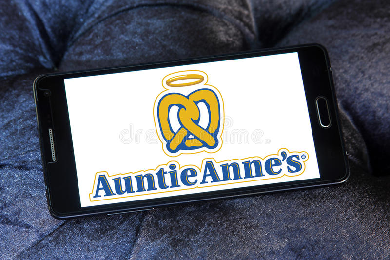 Auntie annes fast food logo. Logo of food franchise and restaurant auntie annes on samsung mobile phone a5 stock photos