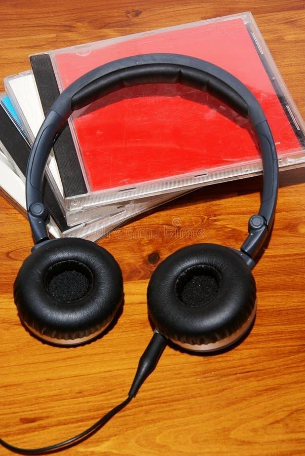 Auricular con el rectángulo cd imagenes de archivo