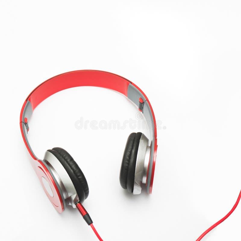 Auricular rojo en blanco fotografía de archivo libre de regalías