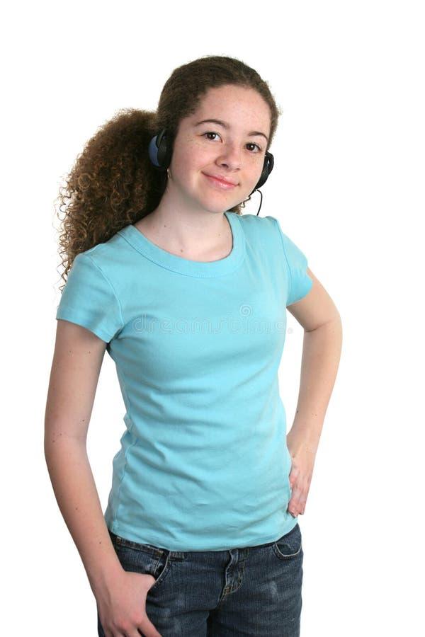 Auriculares azules de la camisa de la muchacha foto de archivo libre de regalías