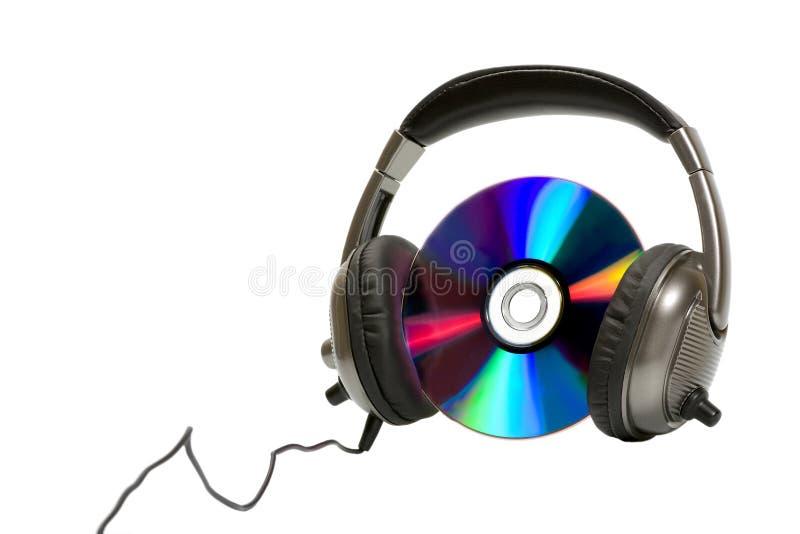 Auriculares con CD fotos de archivo libres de regalías