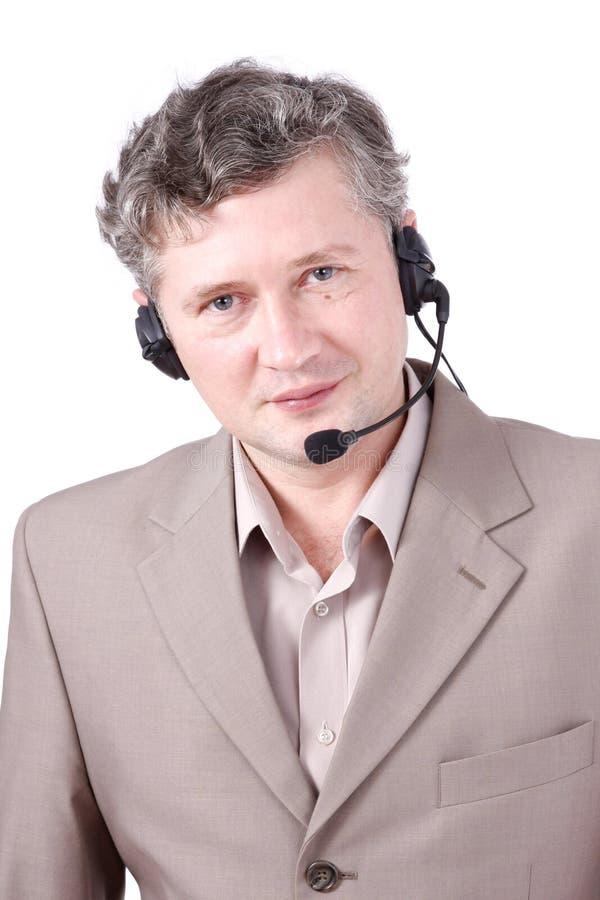 Auriculares desgastando representativos do cliente. imagem de stock
