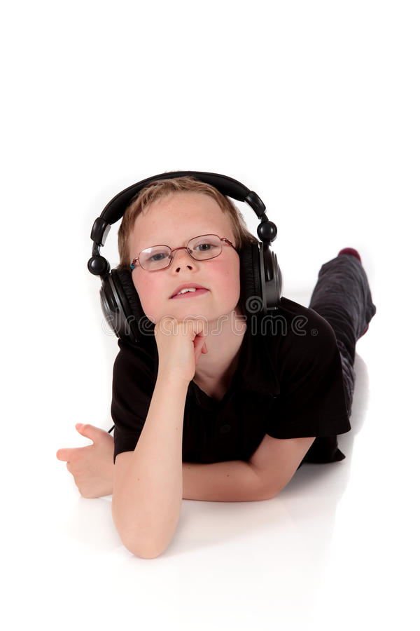 Auriculares do menino de Prodigy imagens de stock royalty free