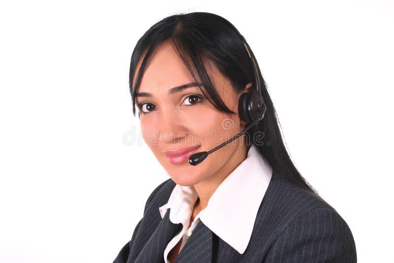 Auriculares e cadeira da mulher fotos de stock