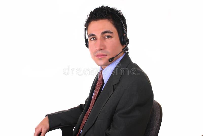 Auriculares e cadeira do homem de negócios foto de stock royalty free