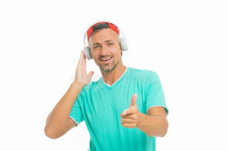 Auriculares inalámbricos para el deporte Concepto moderno de los auriculares Auriculares de la música del deportista sin afeitar  foto de archivo
