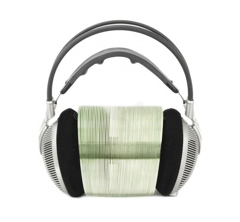 Auriculares para escuchar la música con CD/DVD de las multimedias fotografía de archivo libre de regalías