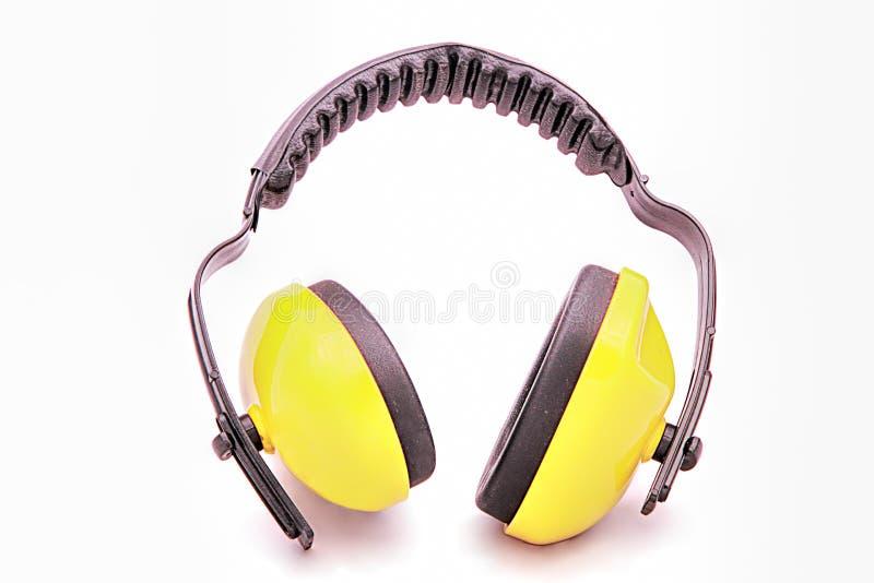 Auriculares protectores del funcionamiento amarillo foto de archivo libre de regalías