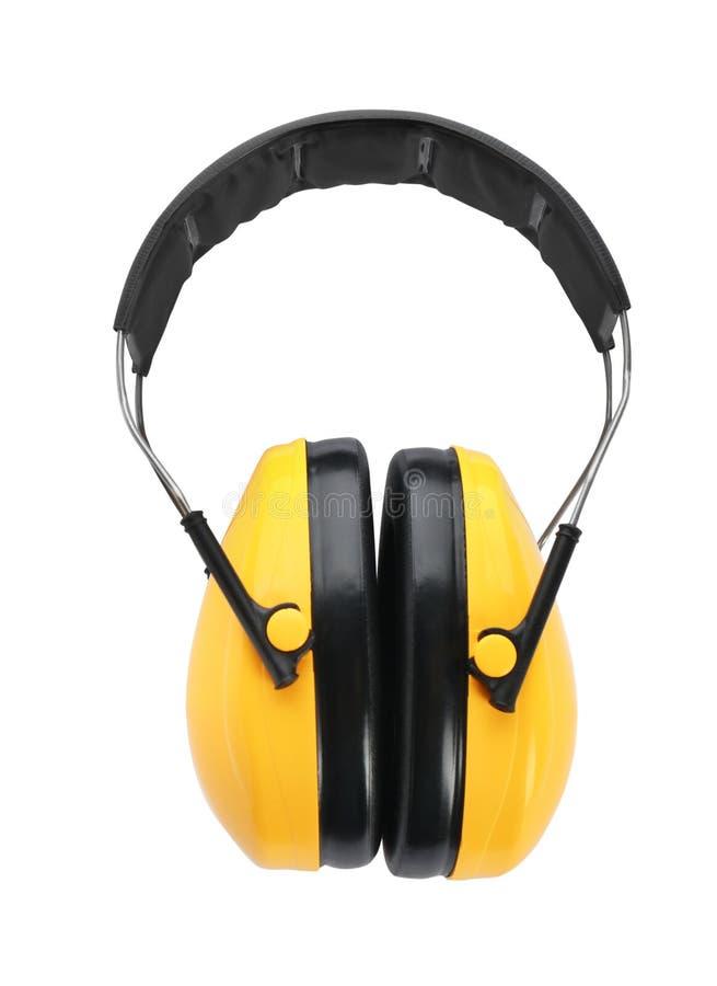 Auriculares protectores en el fondo blanco Seguridad foto de archivo libre de regalías