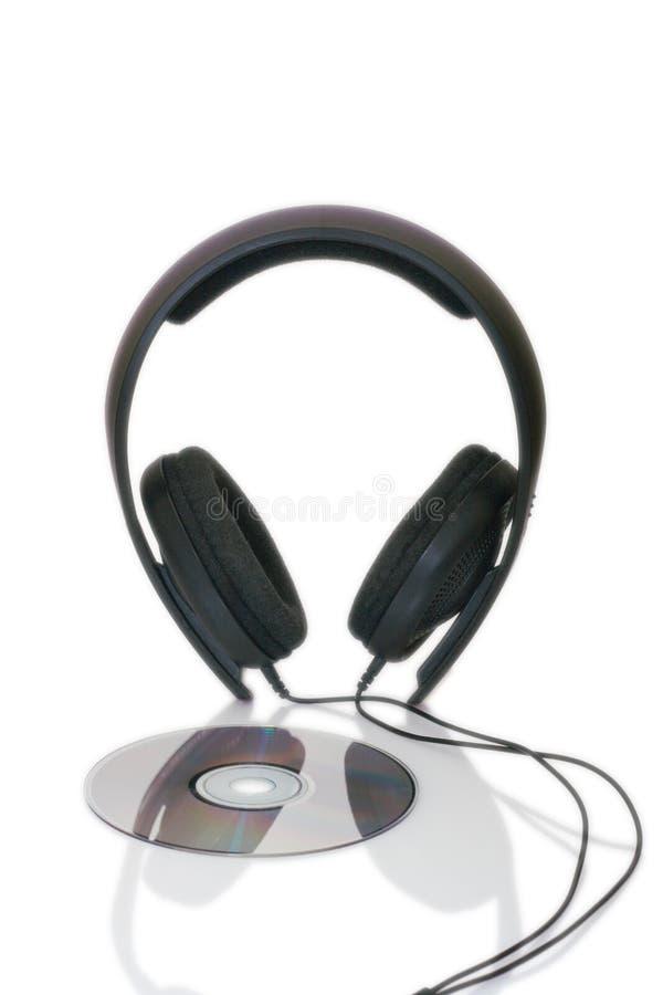 Auriculares y cd-disco fotografía de archivo libre de regalías