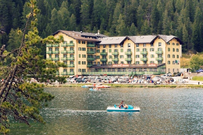 Auronzo di Cadore, Italy August 9, 2018: Misurina Mountain Lake. Beautiful tourist spot. catamarans on the water stock image