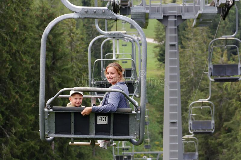 Auronzo di Cadore, Italy A girl with a child ride Mountain lift in the summer stock photo