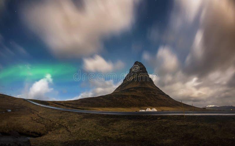 Aurora blasted in sky over Kirkjufell mountain at night, Iceland stock photo