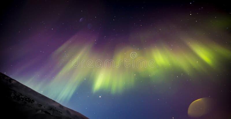 Aurora boreal com alargamento da lente fotografia de stock royalty free