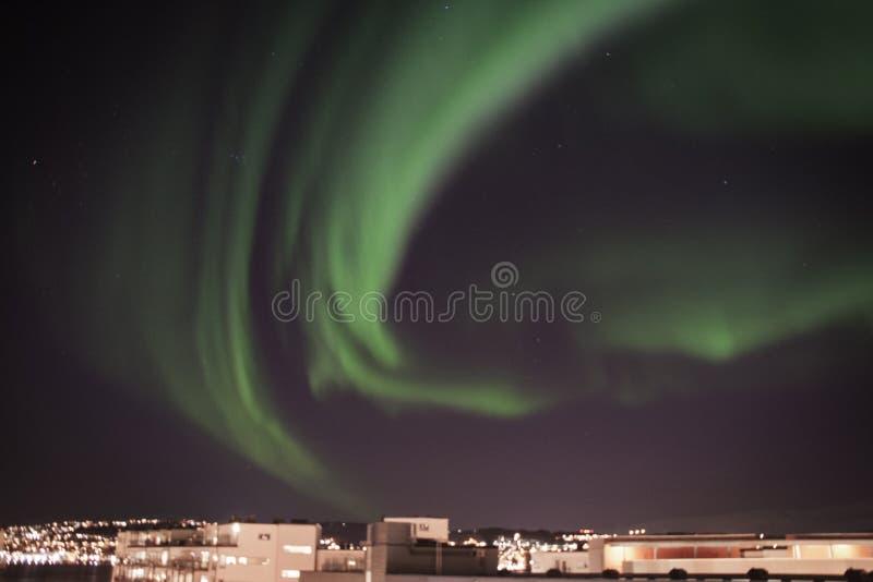 Aurora boreale nel cielo sopra Tromso fotografia stock libera da diritti