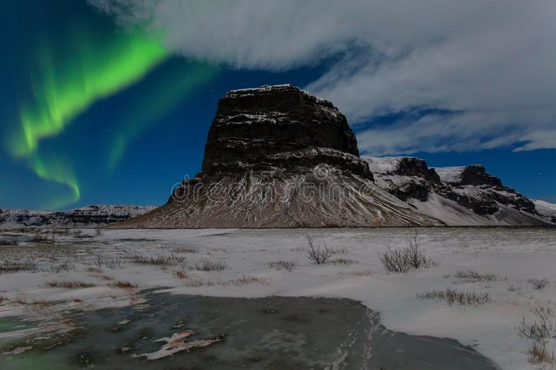 Aurora borealis above the mountains. Reykjavik, Iceland. Green northern lights. Starry sky with polar lights. Night. Winter landscape with aurora royalty free stock photography