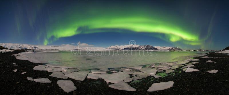 Aurora borealis above the sea. Jokulsarlon glacier lagoon, Iceland. Green northern lights. Starry sky with polar lights. royalty free stock photography