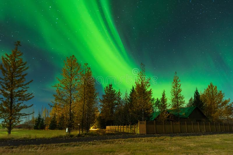 Aurora Borealis in an amazing nightscape. Travel destination with beautiful green lights landscape. royalty free stock photo