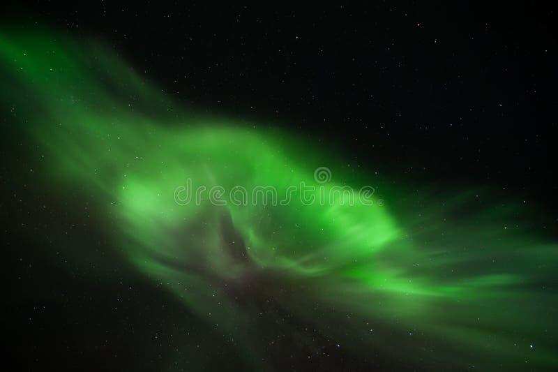 Aurora borealis below stars royalty free stock photo