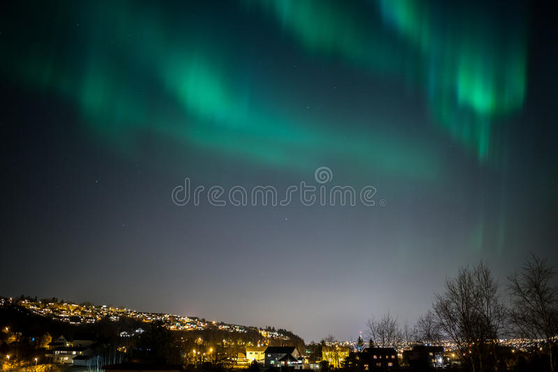 Aurora Borealis Cityscape. True geomagnetic storm in Norway, cityscape of Trondheim royalty free stock images