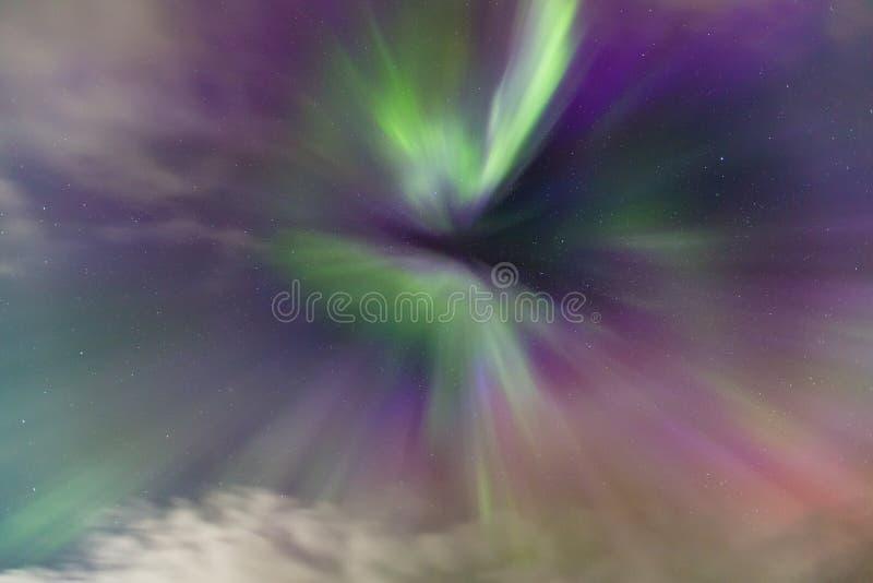 Aurora Borealis Corona. Between clouds stock photography