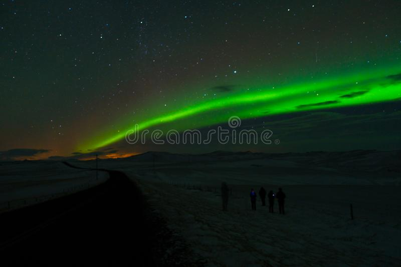 Aurora borealis landscape with people watching stock images